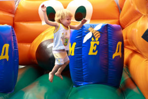 Child jumping on bouncy castle